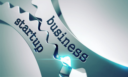 Business Startup on the Mechanism of Metal Cogwheels. Archivio Fotografico