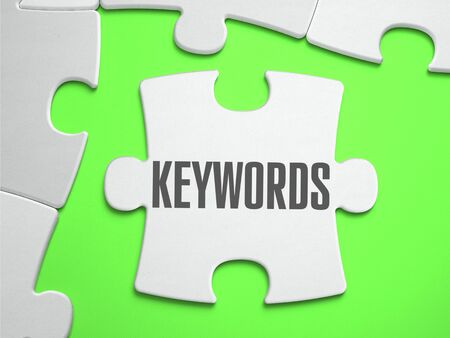 keywords: Keywords - Jigsaw Puzzle with Missing Pieces. Bright Green Background. Close-up. 3d Illustration. Stock Photo