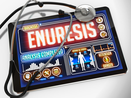 Enuresis - Diagnosis on the Display of Medical Tablet and a Black Stethoscope on White Background. Stock Photo