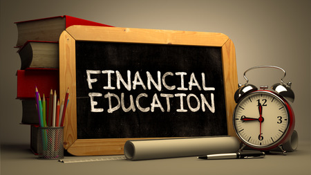 money management: Financial Education Handwritten by white Chalk on a Blackboard. Composition with Small Chalkboard and Stack of Books, Alarm Clock and Rolls of Paper on Blurred Background. Toned Image. Stock Photo