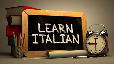 fluent: Learn Italian Concept Hand Drawn on Chalkboard. Blurred Background. Toned Image. Stock Photo