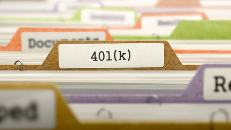 Folder in Colored Catalog Marked as 401K. Closeup View. Selective Focus.