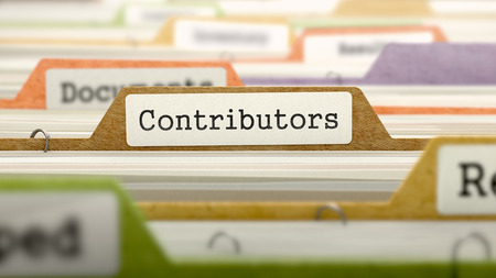 subservience: Contributors on Business Folder in Multicolor Card Index. Closeup View. Blurred Image.