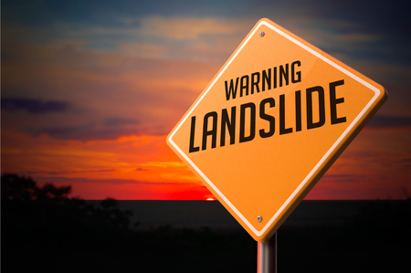 landslide: Landslide on Warning Road Sign on Sunset Sky Background.