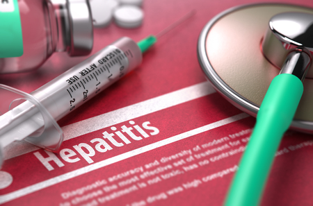 Hepatitis - Medical Concept with Blurred Text, Stethoscope, Pills and Syringe on Red Background. Selective Focus. Foto de archivo
