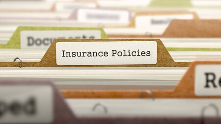 marked: Folder in Colored Catalog Marked as Insurance Policies Closeup View. Selective Focus. Stock Photo