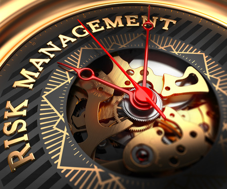 financial risk: Risk Management on Black-Golden Watch Face with Closeup View of Watch Mechanism.