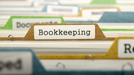 File Folder Labeled as Bookkeeping in Multicolor Archive. Closeup View. Blurred Image.