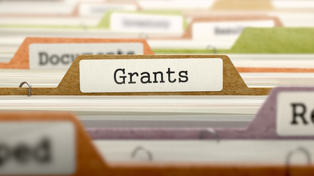 Grants - Folder Register Name in Directory. Colored, Blurred Image. Closeup View.