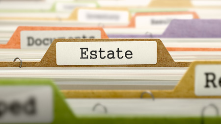 rent index: File Folder Labeled as Estate in Multicolor Archive. Closeup View. Blurred Image.