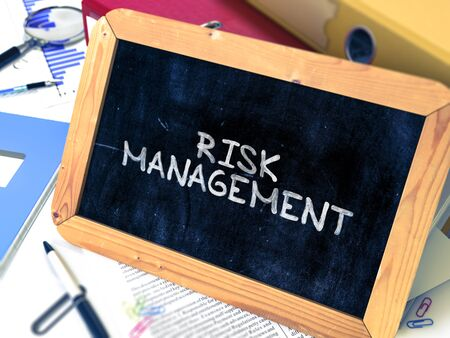 financial diversification: Hand Drawn Risk Management - Business Concept  on Chalkboard. Blurred Background. Toned Image.