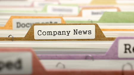 news values: Folder in Colored Catalog Marked as Company News Closeup View. Selective Focus.