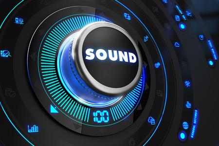 regulator: Sound Regulator on Black Control Console with Blue Backlight. Improvement, regulation, control or management concept.