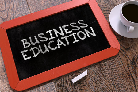 competencies: Business Education - Red Chalkboard With Hand Drawn Text and White Cup of Coffee on Wooden Table. Top View. Stock Photo