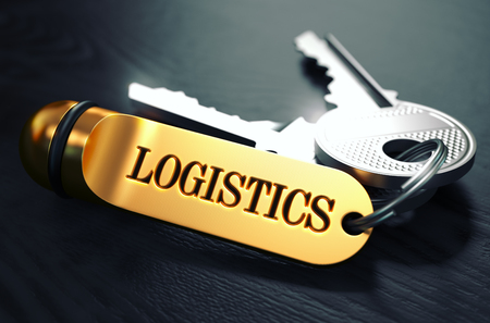 global logistics: Logistics - Bunch of Keys with Text on Golden Keychain. Black Wooden Background. Closeup View with Selective Focus. 3D Illustration. Toned Image. Stock Photo