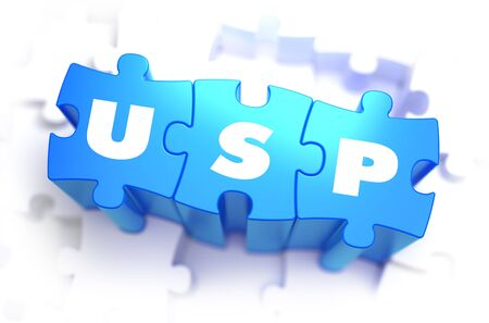 unique selling proposition: USP - Unique Selling Point - White Word on Blue Puzzles on White Background. 3D Illustration.