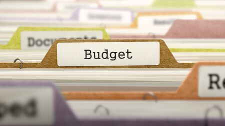 File Folder Labeled as Budget in Multicolor Archive. Closeup View. Blurred Image. Stock Photo