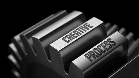 afflatus: Creative Process on the Metal Gears on Black Background. Stock Photo