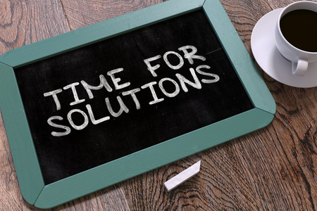 presently: Hand Drawn Inspirational Quote - Time for Solutions - on Small Blue Chalkboard. Business Background. Top View. Stock Photo