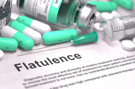 flatulence: Diagnosis - Flatulence. Medical Report with Composition of Medicaments - Light Green Pills, Injections and Syringe. Blurred Background with Selective Focus.