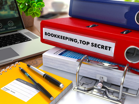stocktaking: Red Ring Binder with Inscription Bookkeeping,Top Secret on Background of Working Table with Office Supplies, Laptop, Reports. Toned Illustration. Business Concept on Blurred Background.