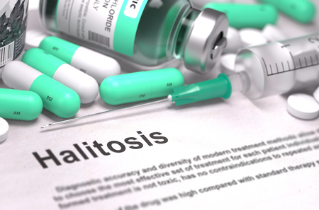 Diagnosis - Halitosis. Medical Concept with Light Green Pills, Injections and Syringe. Selective Focus. Blurred Background. Stock Photo