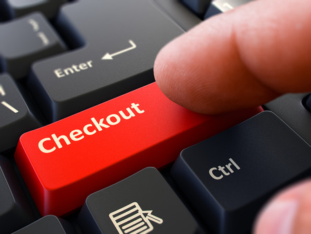checkout button: Computer User Presses Red Button Checkout on Black Keyboard. Closeup View. Blurred Background. Stock Photo