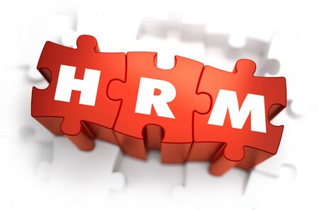 resources management: HRM - Human Resources Management - Text on Red Puzzles with White Background. 3D Render. Stock Photo