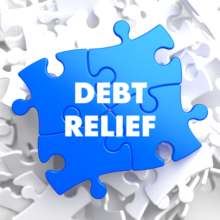 poverty relief: Debt Relief on Blue Puzzle on White Background. Stock Photo