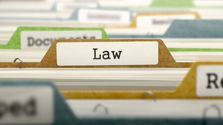 juridical: File Folder Labeled as Law in Multicolor Archive. Closeup View. Blurred Image.