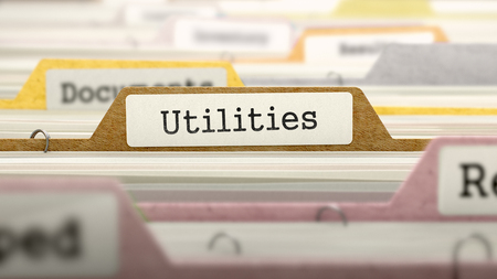 rent index: Utilities on Business Folder in Multicolor Card Index. Closeup View. Blurred Image. Stock Photo