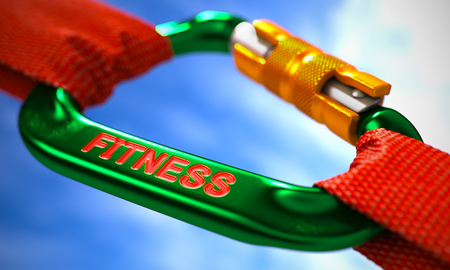 muscularity: Green Carabiner between Red Ropes on Sky Background, Symbolizing the Fitness. Selective Focus. Stock Photo