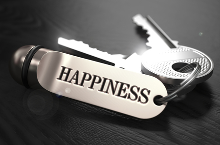 mirth: Keys to Happiness - Concept on Golden Keychain over Black Wooden Background. Closeup View, Selective Focus, 3D Render. Black and White Image. Stock Photo