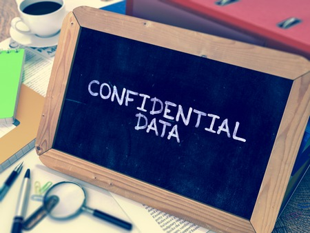 larceny: Confidential Data - Chalkboard with Hand Drawn Text, Stack of Office Folders, Stationery, Reports on Blurred Background. Toned Image.