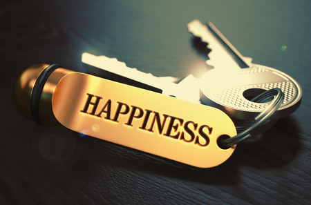 mirth: Keys to Happiness - Concept on Golden Keychain over Black Wooden Background. Closeup View, Selective Focus, 3D Render. Toned Image. Stock Photo