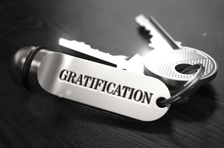 gratification: Gratification Concept. Keys with Keyring on Black Wooden Table. Closeup View, Selective Focus, 3D Render. Black and White Image.