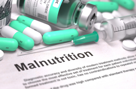 dystrophy: Malnutrition - Printed Diagnosis with Mint Green Pills, Injections and Syringe. Medical Concept with Selective Focus. Stock Photo