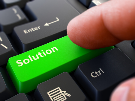 discretion: Solution - Written on Green Keyboard Key. Male Hand Presses Button on Black PC Keyboard. Closeup View. Blurred Background. Stock Photo