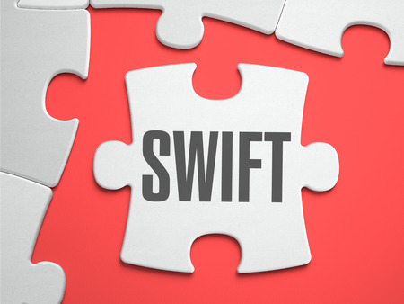 interbank: Swift - Text on Puzzle on the Place of Missing Pieces. Scarlett Background. Close-up. 3d Illustration.