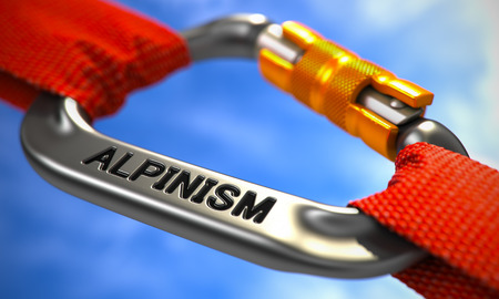 alpinism: Red Ropes Connected by Chrome Carabiner Hook with Text Alpinism. Selective Focus.