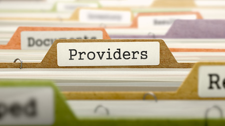 providers: Providers - Folder Register Name in Directory. Colored, Blurred Image. Closeup View. Stock Photo