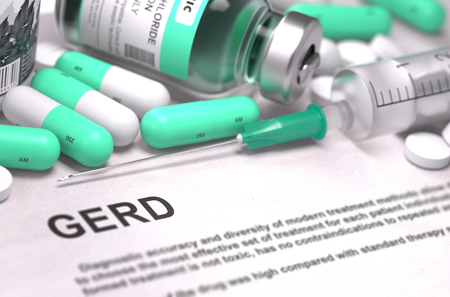 sphincter: GERD - Gastroesophageal Reflux Disease - Printed Diagnosis with Blurred Text. On Background of Medicaments Composition - Mint Green Pills, Injections and Syringe. Stock Photo