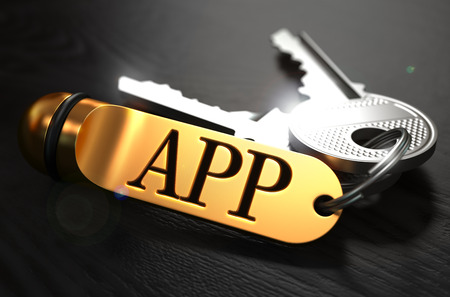 keyring: APP Concept. Keys with Golden Keyring on Black Wooden Table. Closeup View, Selective Focus, 3D Render.