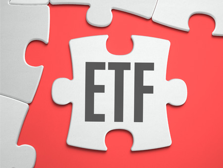 traded: ETF - Exchange Traded Fund - Text on Puzzle on the Place of Missing Pieces. Scarlett Background. Close-up. 3d Illustration. Stock Photo