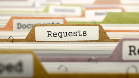 requests: File Folder Labeled as Requests. in Multicolor Archive. Closeup View. Blurred Image.