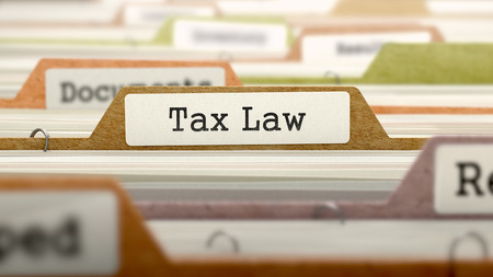 Tax Law - Folder Register Name in Directory. Colored, Blurred Image. Closeup View. Stock Photo