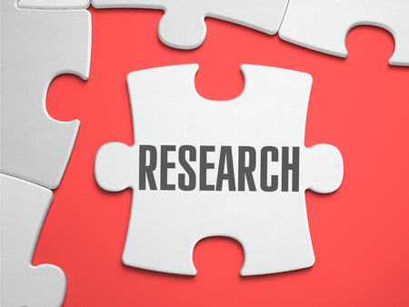 place of research: Research - Text on Puzzle on the Place of Missing Pieces. Scarlett Background. Close-up. 3d Illustration.