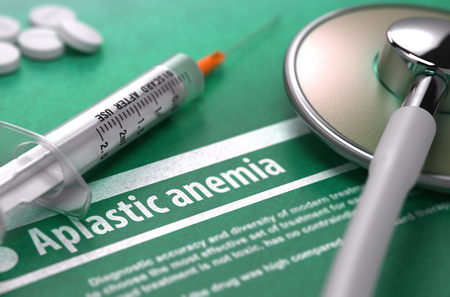 congenital: Aplastic anemia - Medical Concept with Blurred Text, Stethoscope, Pills and Syringe on Green Background. Selective Focus. Stock Photo