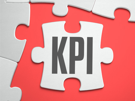 performance appraisal: KPI - Key Performance Indicators - Text on Puzzle on the Place of Missing Pieces. Scarlett Background. Close-up. 3d Illustration.