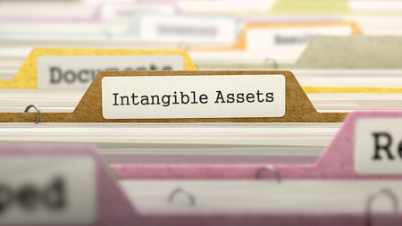 intangible: Intangible Assets Concept. Colored Document Folders Sorted for Catalog. Closeup View. Selective Focus. Stock Photo